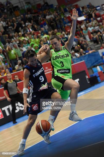 Celine Dumerc of France vies for a ball with Teja Oblak of Slovenia during the FIBA EuroBasket women's basketball match Slovania v France on June 16...