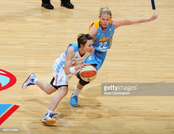 Celine Dumerc of the Atlanta Dream drives against Courtney Vandersloot of the Chicago Sky on June 7 2014 at Philips Arena in Atlanta Georgia NOTE TO...