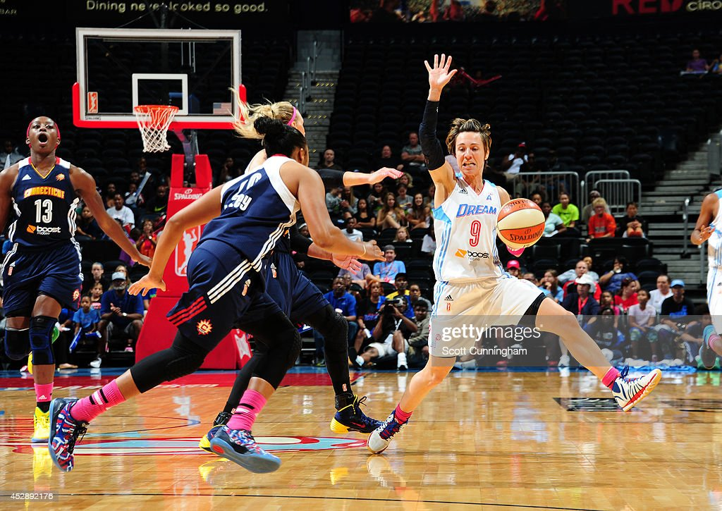 Celine Dumerc #9 of the Atlanta Dream drives against the Connecticut Sun on July 29, 2014 at Philips Arena in Atlanta, Georgia.