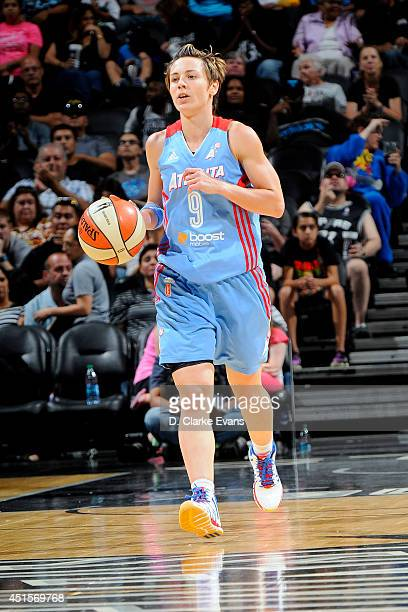 Celine Dumerc of the Atlanta Dream drives against the San Antonio Stars at the ATT Center on June 26 2014 in San Antonio Texas NOTE TO USER User...