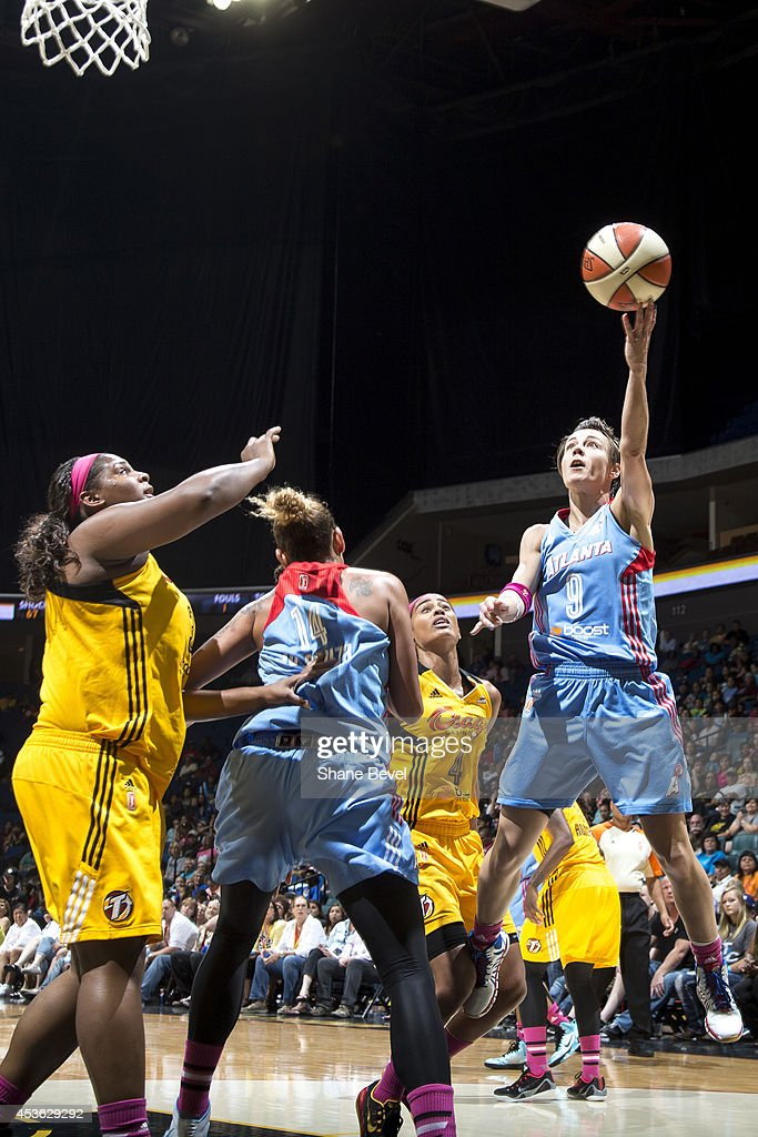 <a gi-track='captionPersonalityLinkClicked' href=/galleries/search?phrase=Celine+Dumerc&family=editorial&specificpeople=625038 ng-click='$event.stopPropagation()'>Celine Dumerc</a> #9 of the Atlanta Dream drives to the basket against Courtney Paris #3 of the Tulsa Shock during the WNBA game on July 29, 2014 at the BOK Center in Tulsa, Oklahoma.