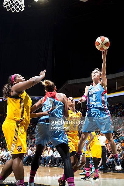 Celine Dumerc of the Atlanta Dream drives to the basket against Courtney Paris of the Tulsa Shock during the WNBA game on July 29 2014 at the BOK...
