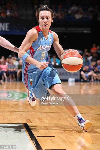 Celine Dumerc of the Atlanta Dream drives to the basket against the Minnesota Lynx during the WNBA game on July 22 2014 at Target Center in...