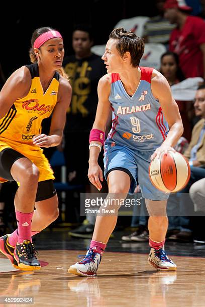 Celine Dumerc of the Atlanta Dream handles the ball against Skylar Diggins of the Tulsa Shock during the WNBA game on July 31 2014 at the BOK Center...