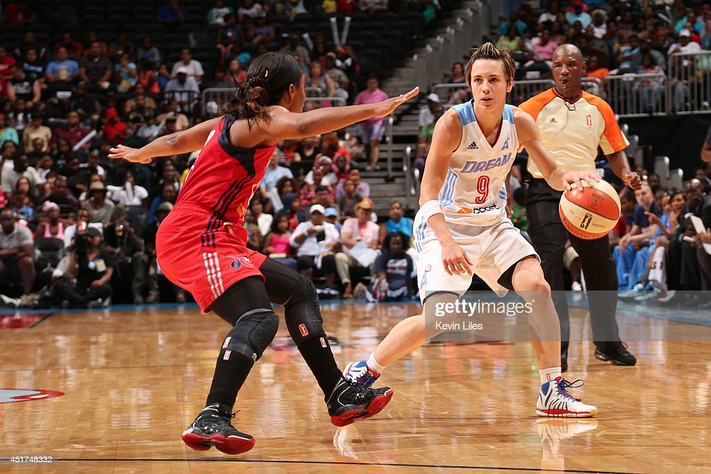 Celine Dumerc #9 of the Atlanta Dream handles the ball against the Washington Mystics at Philips Arena on July 5, 2014 in Atlanta, Georgia.