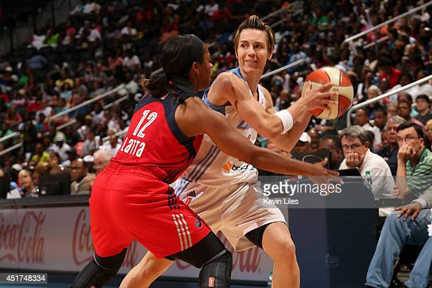 Celine Dumerc of the Atlanta Dream handles the ball against the Washington Mystics at Philips Arena on July 5 2014 in Atlanta Georgia NOTE TO USER...