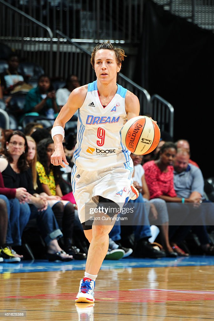 Celine Dumerc #9 of the Atlanta Dream handles the ball against the Indiana Fever on July 1, 2014 at Philips Arena in Atlanta, Georgia.
