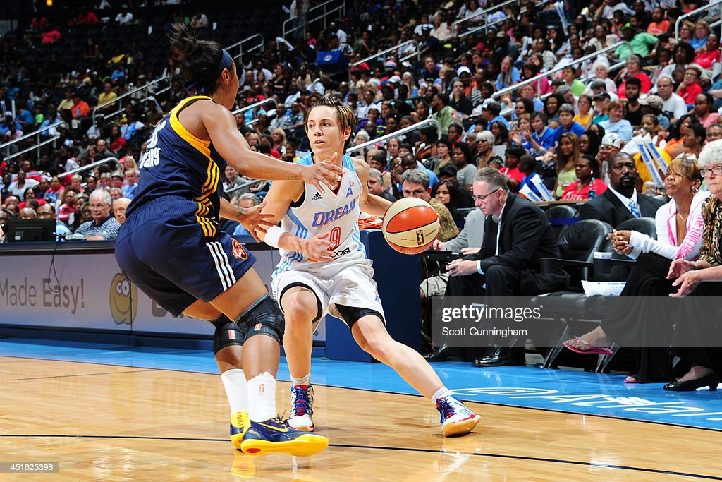 <a gi-track='captionPersonalityLinkClicked' href=/galleries/search?phrase=Celine+Dumerc&family=editorial&specificpeople=625038 ng-click='$event.stopPropagation()'>Celine Dumerc</a> #9 of the Atlanta Dream handles the ball against the Indiana Fever on July 1, 2014 at Philips Arena in Atlanta, Georgia.