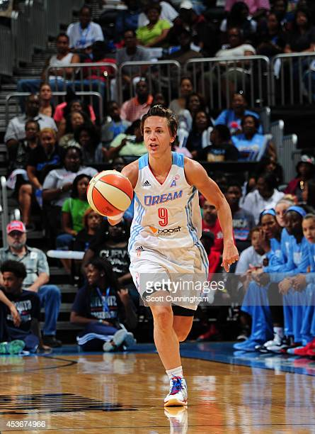 Celine Dumerc of the Atlanta Dream handles the ball against the Tulsa Shock on August 15 2014 at Philips Arena in Atlanta Georgia NOTE TO USER User...