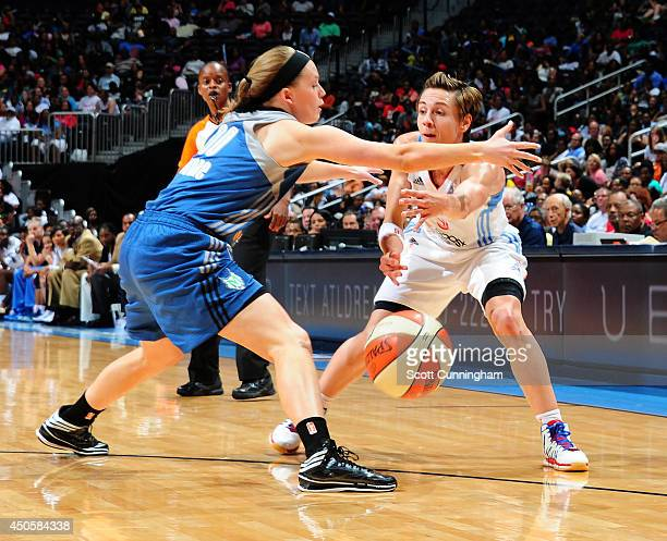 Celine Dumerc of the Atlanta Dream passes against the Minnesota Lynx on June 13 2014 at Philips Arena in Atlanta Georgia NOTE TO USER User expressly...