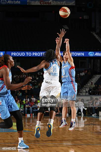 Celine Dumerc of the Atlanta Dream shoots against Epiphanny Prince of the Chicago Sky on August 10 2014 at the Allstate Arena in Rosemont Illinois...