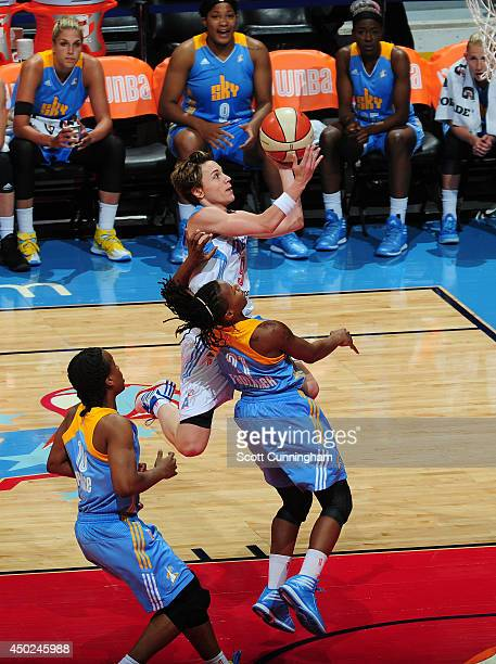 Celine Dumerc of the Atlanta Dream shoots against Jamierra Faulkner of the Chicago Sky on June 7 2014 at Philips Arena in Atlanta Georgia NOTE TO...
