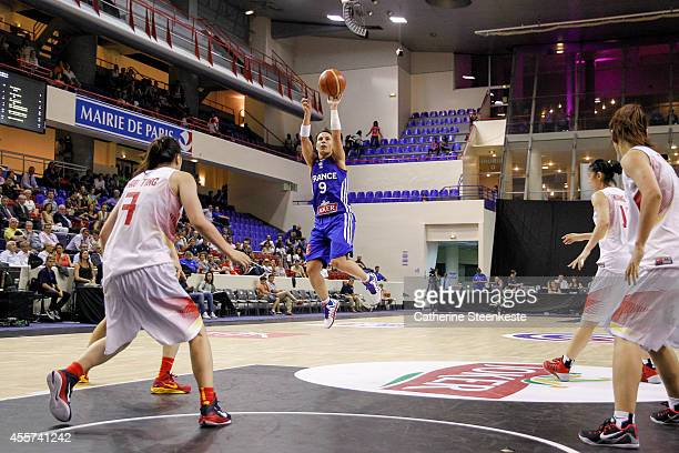 Celine Dumerc of the French Basketball Women's National Team shoots a three point during the game between France and China at Stade Pierre de...