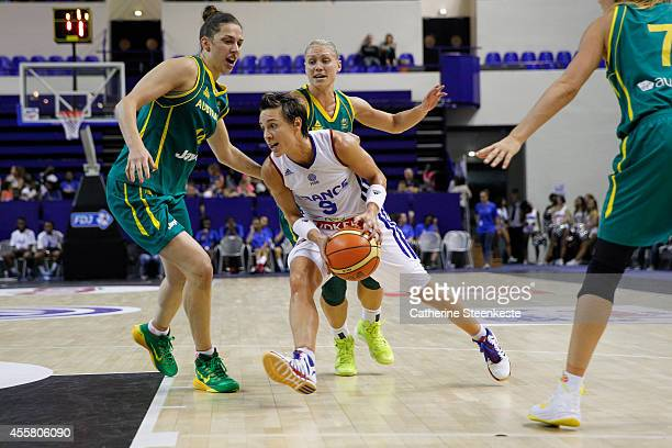Celine Dumerc of the French Basketball Women's National Team tries to drive to the basket against Marianna Tolo and Erin Phillips of the Australian...