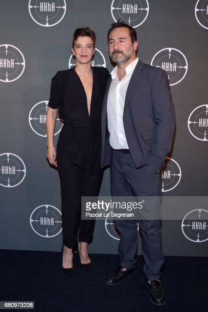 Celine Salette and Gilles Lellouche attend 'HHHH' Paris Premiere at Cinema UGC Normandie on May 9 2017 in Paris France