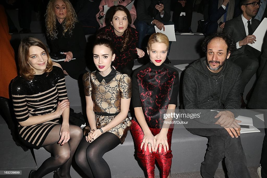 Celine Sallette, Lily Collins, Lea Seydoux and Luca Guadagnino attend the Louis Vuitton Fall/Winter 2013 Ready-to-Wear show as part of Paris Fashion Week on March 6, 2013 in Paris, France.