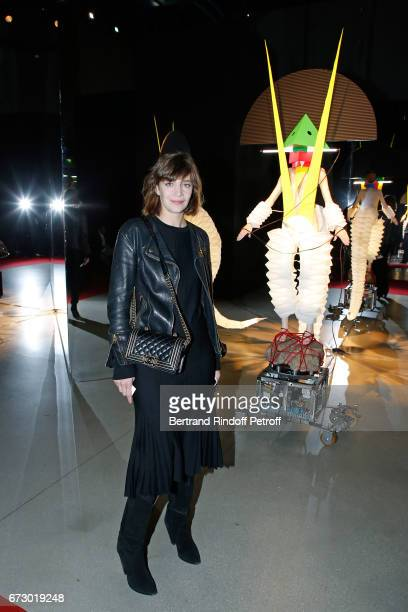Celine Sallette poses in front the works of JeanPaul Goude during the 'Societe des Amis du Musee d'Art Moderne du Centre Pompidou' Dinner Party Held...