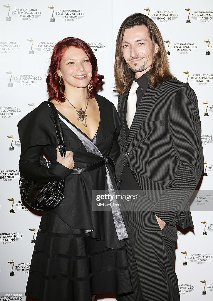 Celine Tricart (L) and guest arrive at the 2014 International 3D and Advanced Imaging Society's Creative Arts Awards held at Steven J. Ross Theatre on January 28, 2014 in Burbank, California.