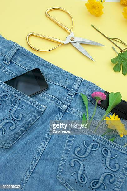 Cell phone in jeans florist  pocket