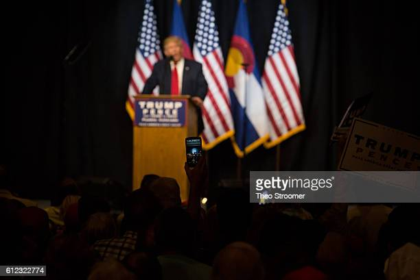 A cell phone shows Republican presidential nominee Donald Trump speaking at a political rally held at the Pueblo Convention Center on October 3 2016...