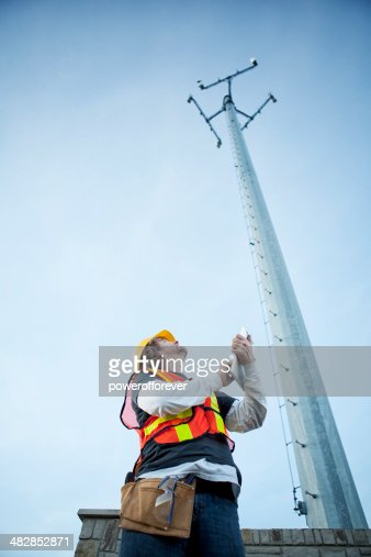 Cell Phone Tower Technician with Tablet Computer