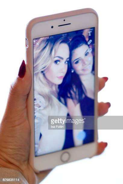 Cell phone view of TV actress Angelina Heger and TV actress Tanja Tischewitsch during the Urban Decay Naked Heat Launch at House of weekend on August...