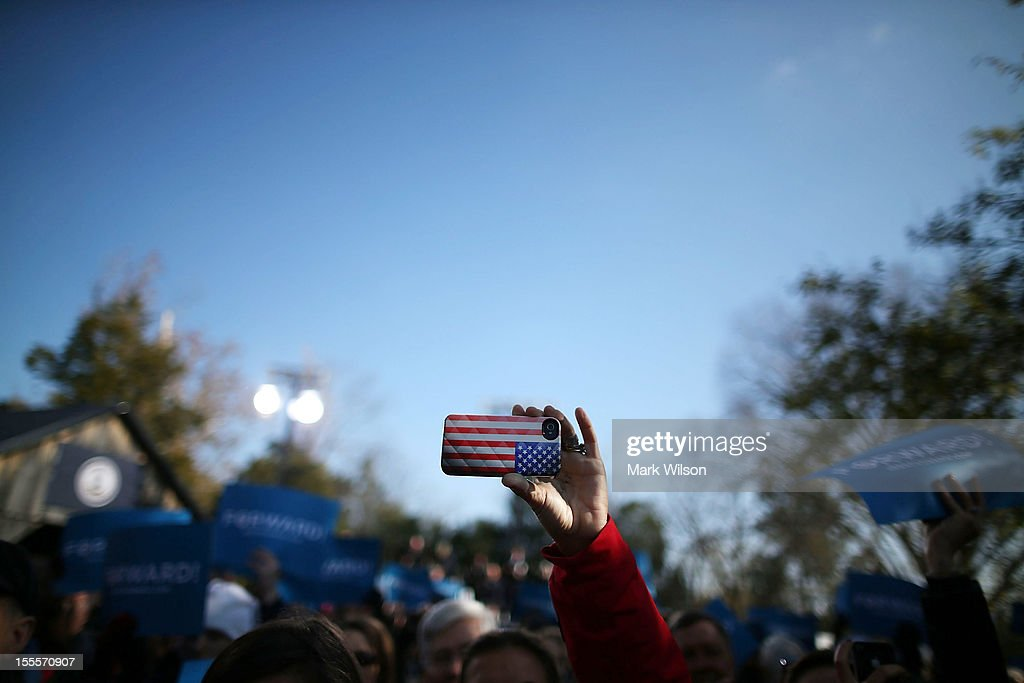 A cell phone with an American flag cover is held up as U.S. Vice President Joe Biden speaks during a campaign rally at the Heritage Farm Museum, on November 5, 2012 in Sterling, Virginia. Tomorrow voters nationwide will head to the polls to vote in the presidential and congressional elections.