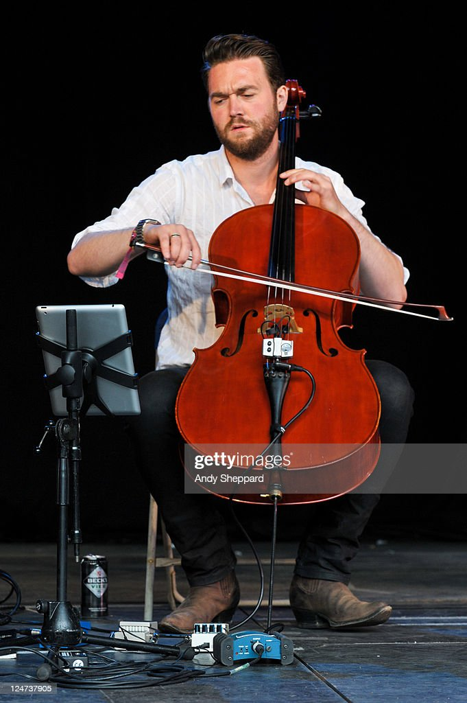 Cellist Ben Trigg of The Leisure Society performs on stage using an iPad held in a bespoke music stand during End Of The Road Festival 2011 at Larmer Tree Gardens on September 4, 2011 in Farnham, United Kingdom.