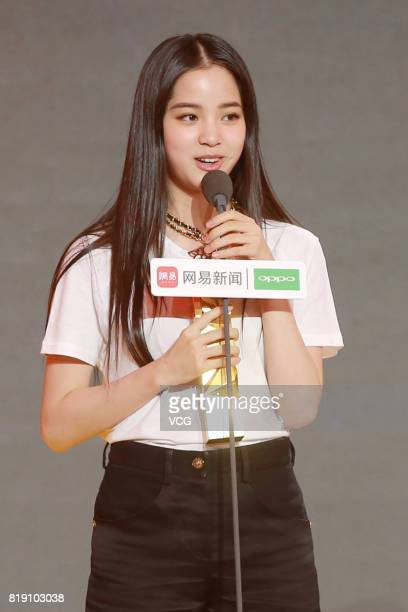 Cellist Nana Ouyang poses with her trophy during the 2017 NetEase Entertainment Ceremony on July 19 2017 in Beijing China