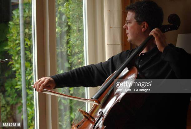 Cellist Paul Watkins practices at home with an 18th century Stradivarius cello he will be playing at the Proms Richmond west London