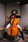 Cellist rehearsing in studio