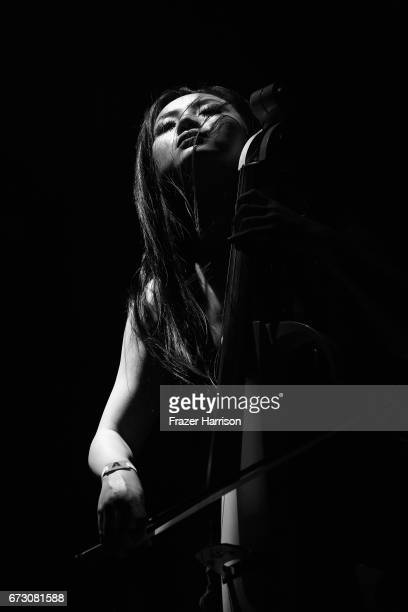Cellist Tina Guo performs with Hans Zimmer on the Outdoor Theatre during day 3> on April 23 2017 in Indio California