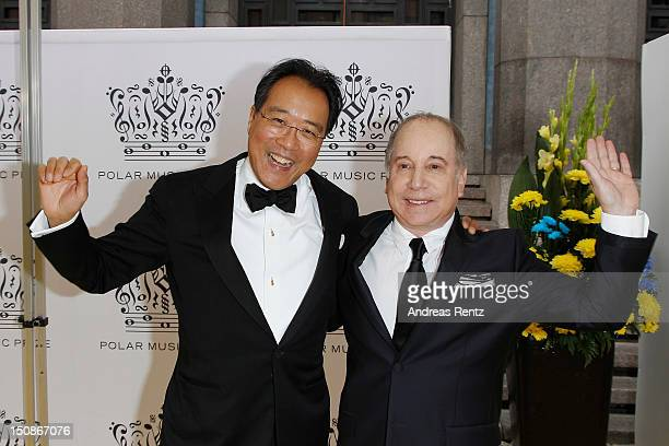 Cellist YoYo Ma and artist Paul Simon arrive for the Polar Music Prize at Konserthuset on August 28 2012 in Stockholm Sweden