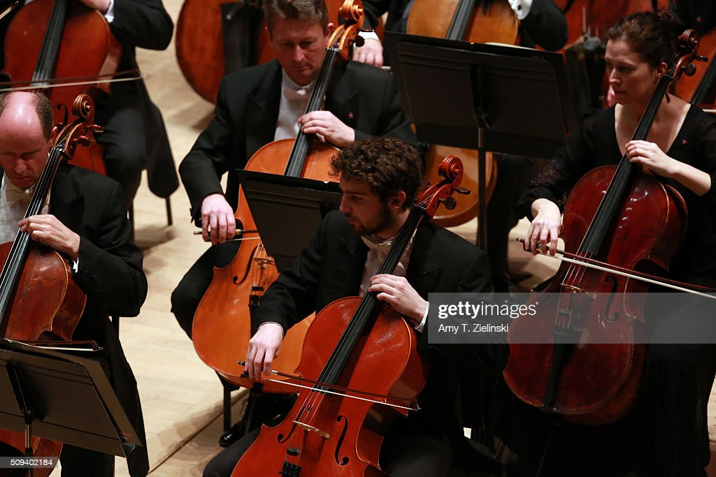 Cellists perform as English pianist Stephen Hough plays at the piano as Finnish conductor Osmo Vanska leads the London Philharmonic Orchestra in composer Antonin Dvorak's Piano Concerto in G minor in the Southbank Centre's the Royal Festival Hall on February 10, 2016 in London, England.