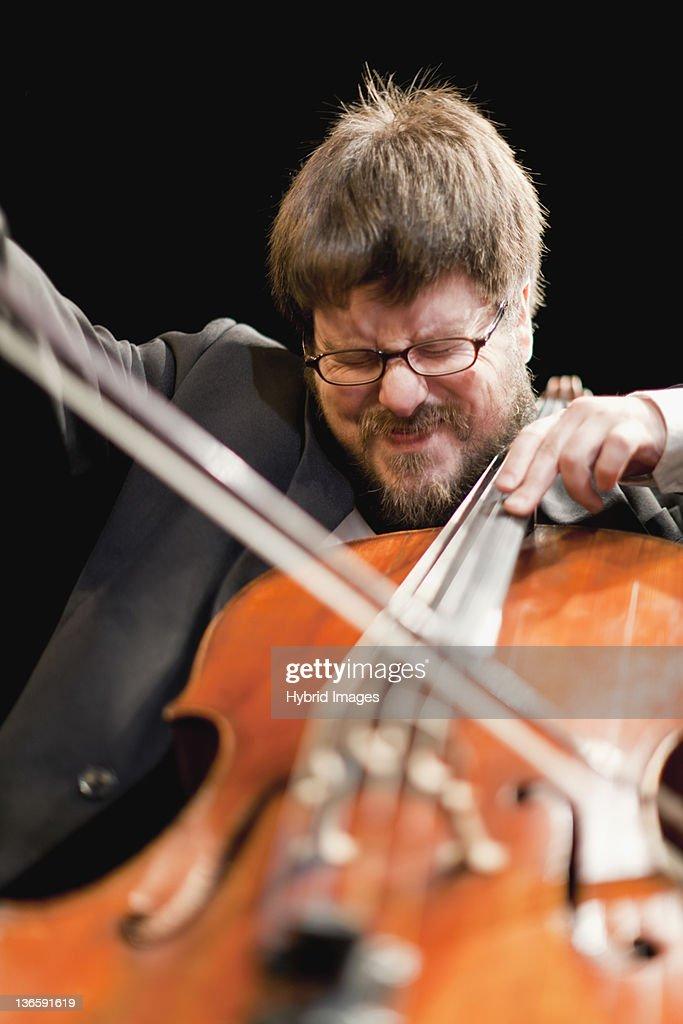 Cello player in orchestra : Stock Photo