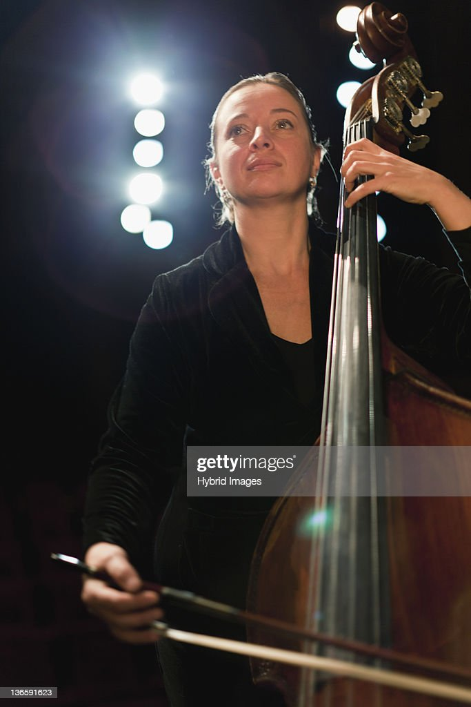 Cello player in orchestra : Stock Photo