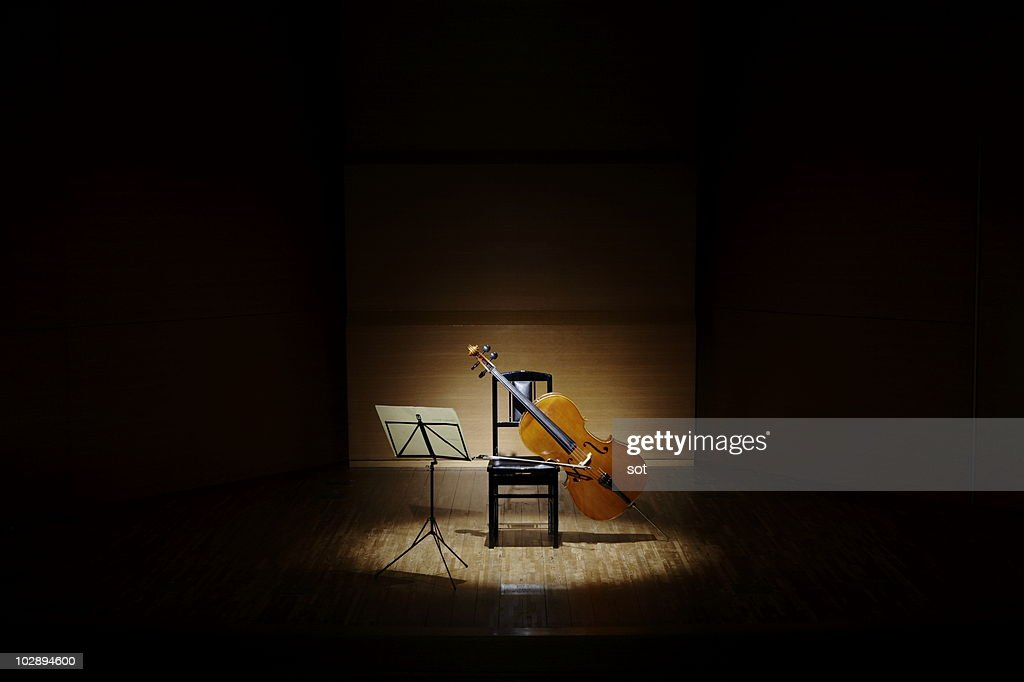 Cello with chair and music stand on stage. : Stock Photo