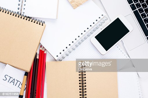 Cellphone and notepads : Stock Photo