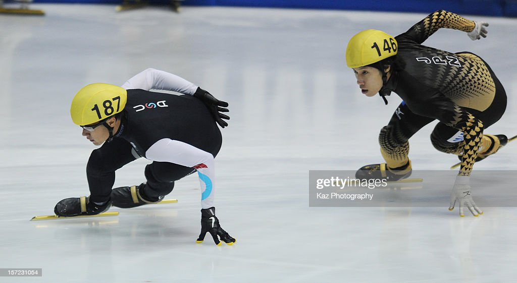 <a gi-track='captionPersonalityLinkClicked' href=/galleries/search?phrase=J.R.+Celski&family=editorial&specificpeople=5581262 ng-click='$event.stopPropagation()'>J.R. Celski</a> of USA leads <a gi-track='captionPersonalityLinkClicked' href=/galleries/search?phrase=Ryosuke+Sakazume&family=editorial&specificpeople=5629753 ng-click='$event.stopPropagation()'>Ryosuke Sakazume</a> of Japan in Race 3 of Men 1000m Preliminaries during day one of the ISU World Cup Short Track at Nippon Gaishi Arena on November 30, 2012 in Nagoya, Japan.