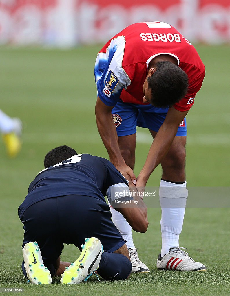 Celso Borges #5 of Costa Rica consoles Dalton Eiley of Belize after the game at a CONCACAF Gold Cup match July 13, 2013 at Rio Tinto Stadium in Sandy, Utah. Costa Rica defeated Belize 1-0.