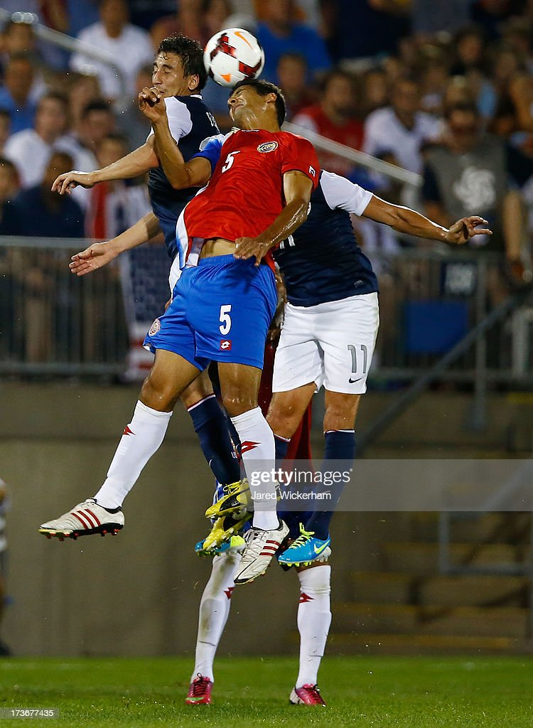 Celso Borges #5 of Costa Rica goes up for a header against the United States in the second half during the CONCACAF Gold Cup match at Rentschler Field on July 16, 2013 in East Hartford, Connecticut.
