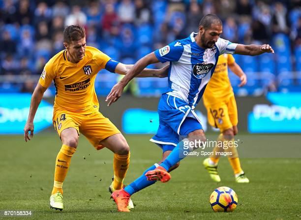Celso Borges of Deportivo de La Coruna is challenged by Gabi Fernandez of Atletico de Madrid during the La Liga match between Deportivo La Coruna and...