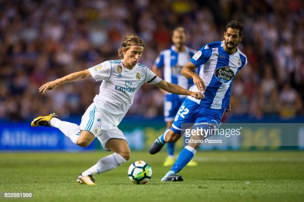 Celso Borges of RC Deportivo La Coruna competes for the ball with Luka Modric of Real Madrid during the La Liga match between Deportivo La Coruna and...