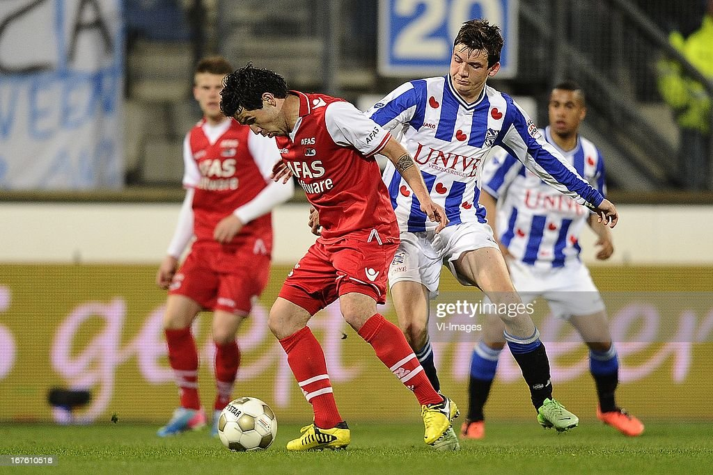Celso Ortiz of AZ, Marten de Roon of sc Heerenveen, during the Dutch Eredivisie match between sc Heerenveen and AZ Alkmaar on April 26, 2013 at the Abe Lenstra stadium in Heerenveen, The Netherlands.