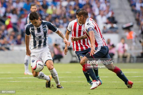 Celso Ortiz of Monterrey fights for the ball with Carlos Salcido of Chivas during the 4th round match between Monterrey and Chivas as part of the...
