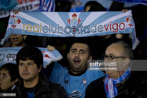 Celta de Vigo fans with their scarfs standed sign their hymn prior to start the La Liga match between RC Celta de Vigo and FC Barcelona at Estadio...