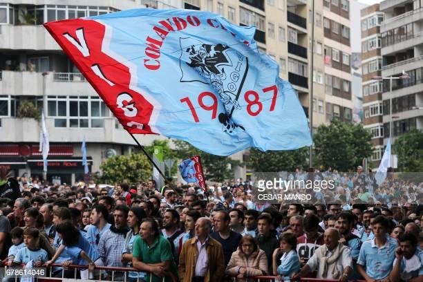 A Celta de Vigos's fan waves a flag outside the stadium before their UEFA Europa League semi final first leg football match RC Celta de Vigo vs...