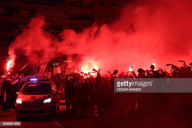Celta supporters wave scarves and light flares as his team's coach arrives before the Spanish Copa del Rey semifinal second leg football match RC...