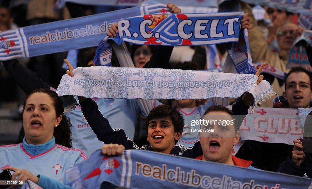 Celta Vigo fans cheer their team during the La Liga match between Celta Vigo and Real Madrid CF at Estadio Balaidos on April 26 2015 in Vigo Spain