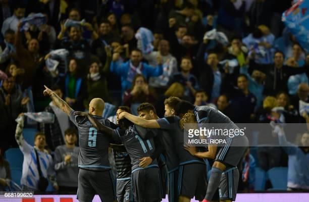 Celta Vigo players celebrate a goal during the UEFA Europa League quarter final 1st leg football match at the Balaidos stadium in Vigo on April 13...